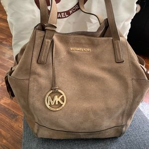 Micheal Kors. Large unstructured tan suede bag.